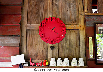 Interior decorate with red clock on wooden wall