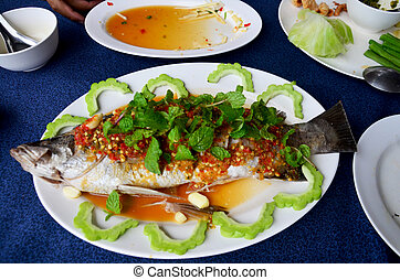 Steamed snapper fish with lemon and chili sauce , hot and...