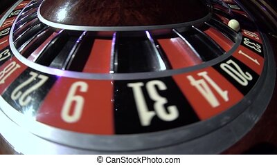Roulette wheel spinning in the casino. Number 16. Close up -...