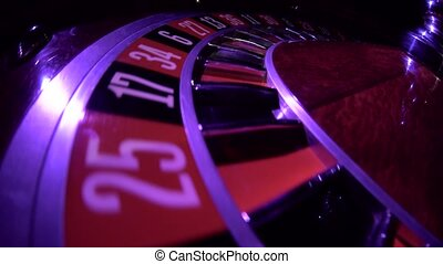 Usual roulette wheel running with fallen white ball, top...