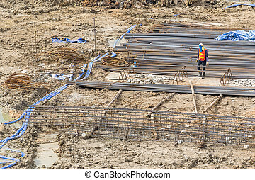 Construction workers are preparing pump for concrete for...