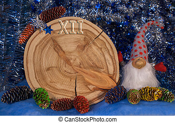 Larch saw cut in the form of dial with arrows, painted fir...