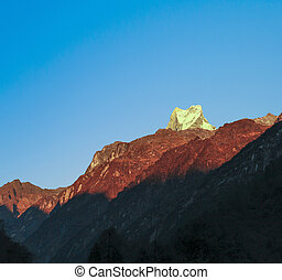 Silhouette of mount Machapuchare, Annapurna area, morning...