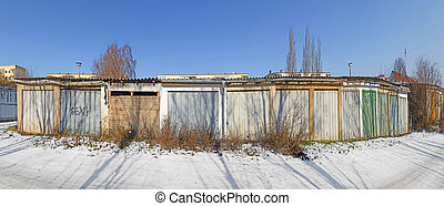 old garage doors in a row in the GDR, former socialistic...