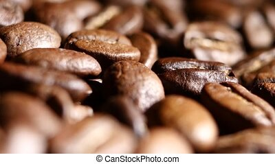 Loop able background of coffee beans. Rotating. Close up