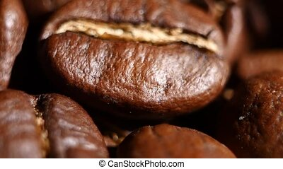 Light roasted coffee beans. Rotating. Close up