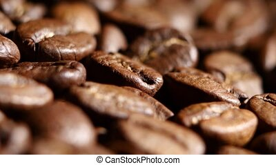 Coffee beans. Rotating. Close up - Pile of roasted coffee...