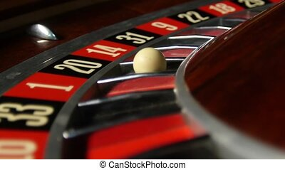 Roulette wheel loop rotation. Number 20 black. Close up -...