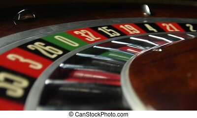 Roulette wheel spinning in the casino. Number 18 red. Close...