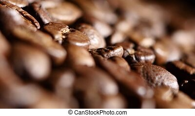 Aromatic roasted coffee beans. Close up. Rotsting - Coffee...