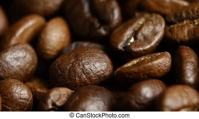 Coffee bean background. Close up. Rotating - Coffee bean...