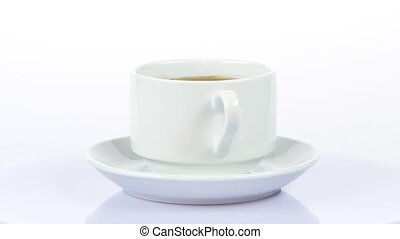 Cup of coffee. Rotating. White