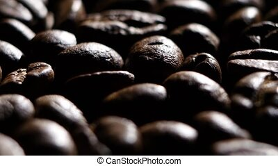 Coffee beans. Close up. Rotating. Backlight