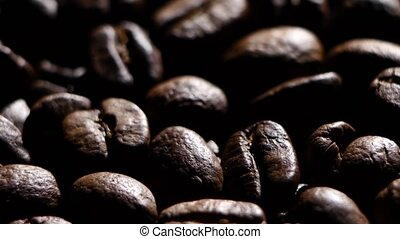 Aroma of coffee beans. Rotating. Close up. Backlight - Pile...