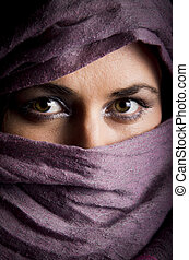 Beautiful arabian woman in color yashmak