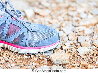 Running shoes on stony ground - Close up photo of running...