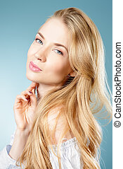 natural blonde hair - Cute young woman with beautiful blonde...