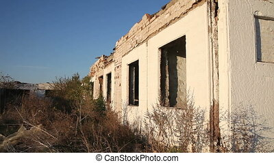 Destroyed building livestock farms. The ruins of the...