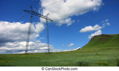 Power Lines - Time-lapse blue sky electricity pylon white...