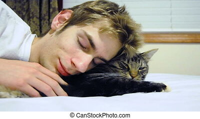 Young Man Snuggles A Pet Maine Coon
