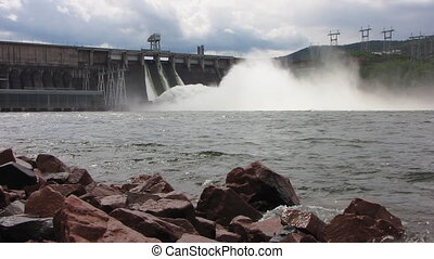 Dam spillway into river - A dam with hydropower generators