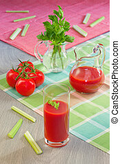 Glass with tomato juice, tomatoes, stalks and leaves of a...