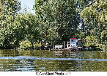 Boat on the riverside in Danube Delta - Boat on the...
