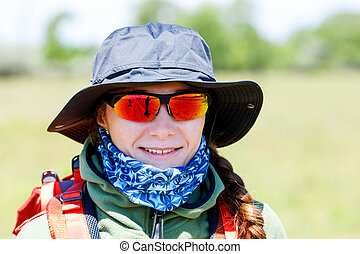 Hiker young woman portrait - Close up photo of smiling hiker...