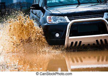 suv splash on the river outdoor ,traveling on the road