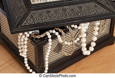 chest - old chest with pearl necklace