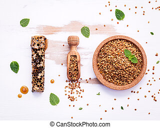 Raw organic bee pollen on shabby wooden board. Bee pollen granules and propolis in wooden scoop. Homeopathic food concept with bee pollen with peppermint and thyme flat lay on wooden background