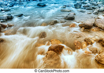 River water flowing through rocks at dawn, Sikkim, India -...
