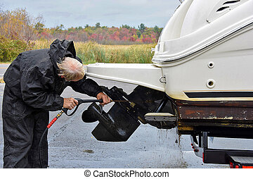 man cleaning boat prop - Caucasian man cleaning boat prop...