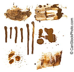 set drops of mud sprayed isolated on white background,...