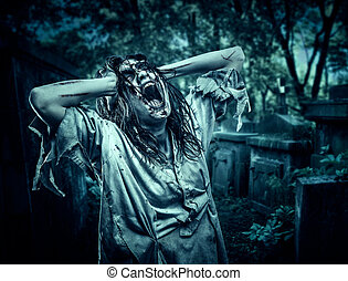The shouting female zombie. Cemetery. Halloween. - The...