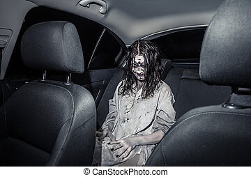 Horror zombie woman with bloody face in the car