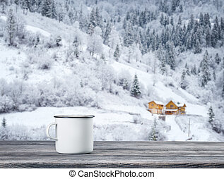 White cup of tea on wooden table against background of hotel...