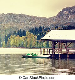 Snowy roof for holiday paddle boats. Holiday resort - Snowy...
