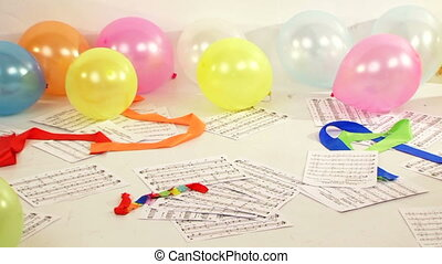 Scores - The set of musical notes scattered on the floor....