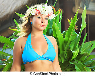 Woman in resort - Young woman wearing wreath at the resort