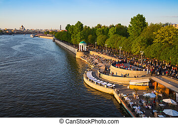 People walking on embankment of the Moscow river - Moscow,...
