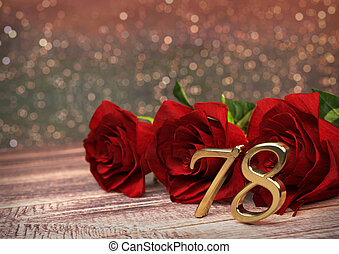 birthday concept with red roses on wooden desk....