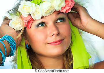 Woman in wreath - Close-up portrait of a young beautiful...
