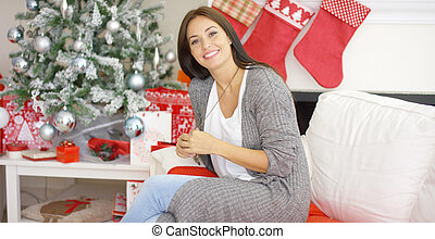 Friendly young woman relaxing at home Christmas - Friendly...