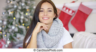 Stylish pretty woman celebrating Christmas at home in a...