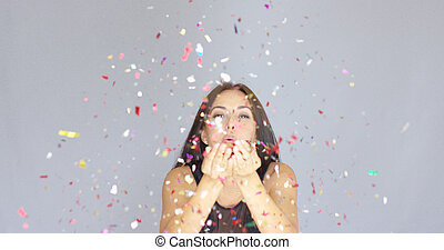 Merry young woman celebrating the New Year at a party...