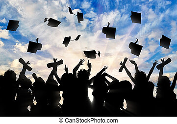 Students graduate cap throwing in sky. Study concept