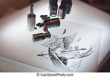 Tattoo equipment and scetch was prepared for making tattoo...