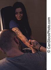 Tattooer makes scetch - Tattooer is drawing scetch on the...