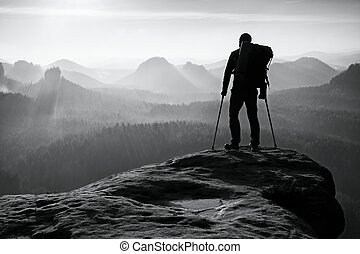 Tourist with leg in immobilizer. Hiker silhouette with...